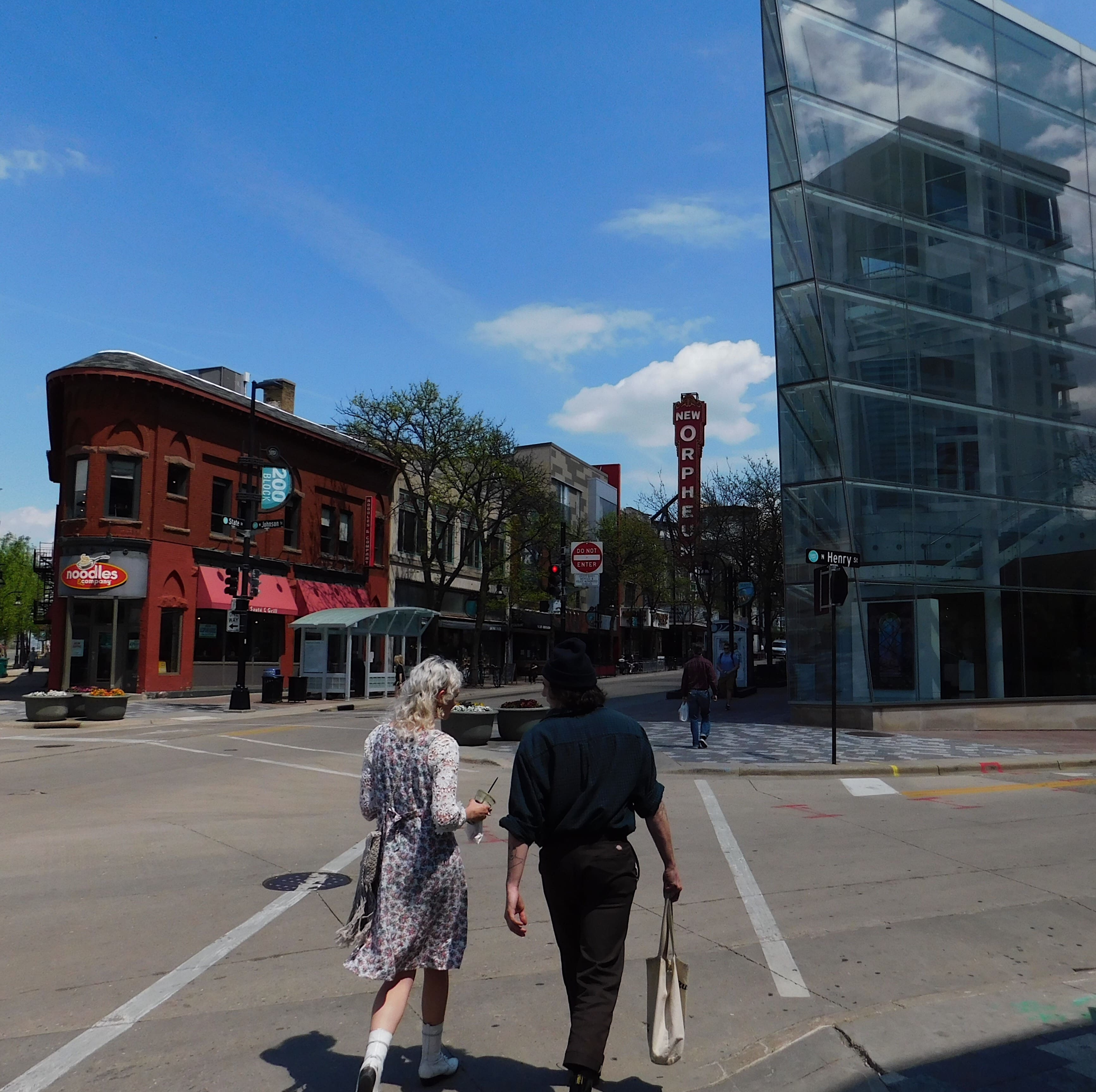 A young couple walks along state street